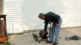 Starting an electric pressure washer.